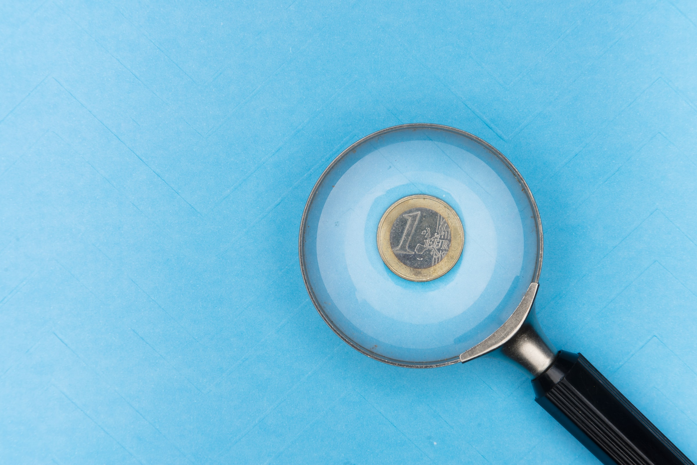 A magnifying glass over a coin